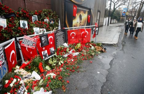 Flowers and pictures of the victims are placed near the entrance of Reina nightclub in Istanbul, Turkey, January 17, 2017. REUTERS/Osman Orsal